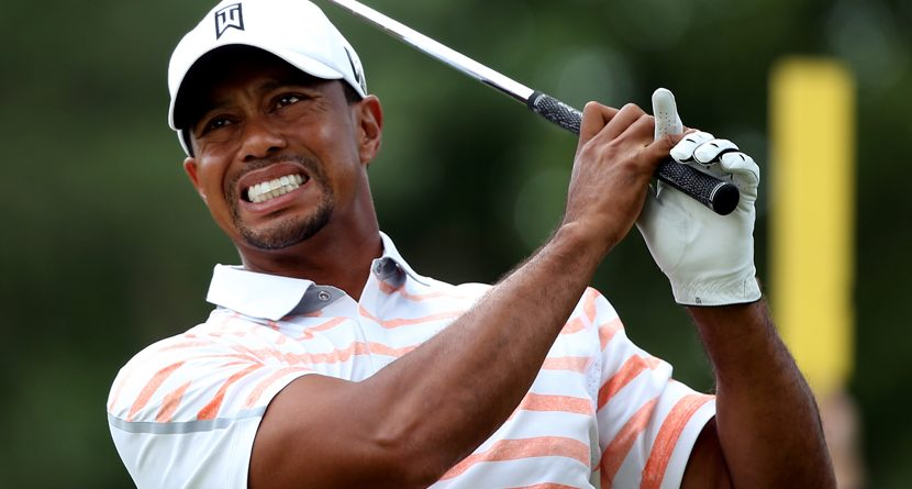 Tiger Woods Battles Elbow Injury At Merion