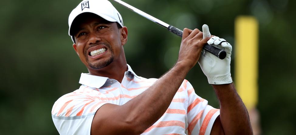 Tiger Woods Battles Elbow Injury At Merion