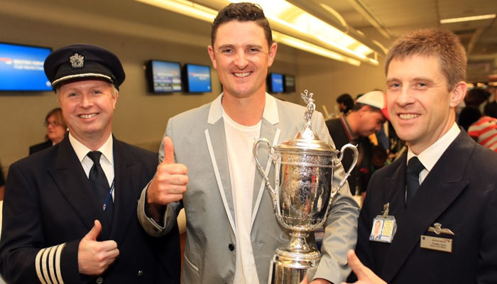 Orlando Airport, Jun 30: British Airways pilot Captain Greig Law and First Officer Francis Gray, greet US Open Champion Justin Rose and the US Open Trophy at Orlando Airport as they prepare to fly them to the UK in advance of the Open Championship (British Open).