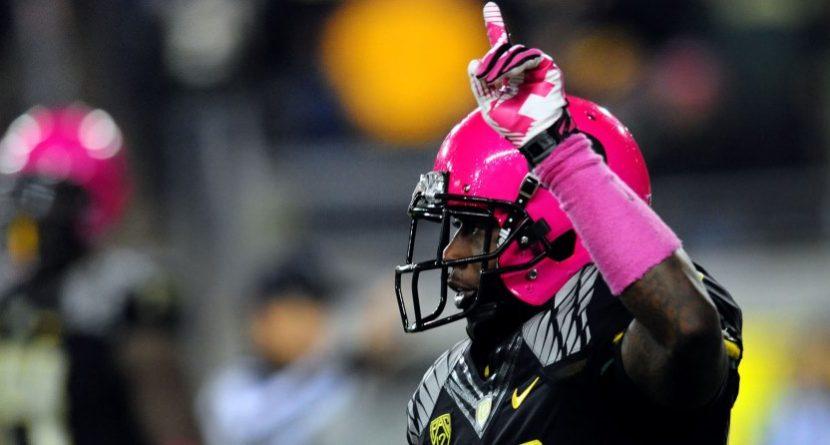 Ahmad Rashad Signs Pink Oregon Helmet For Kay Yow Cancer Fund