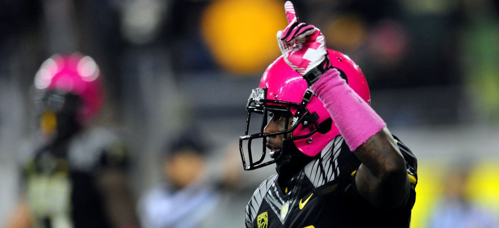Ahmad Rashad Signs Pink Oregon Helmet For Kay Yow Cancer Fund