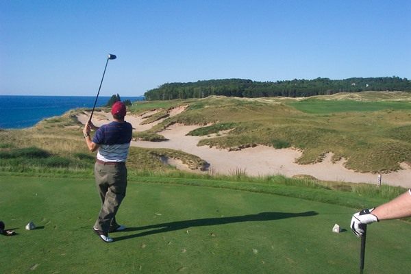 Christopher Hart follows through at Arcadia Bluffs. (Photo courtesy of Chuck Pinter)