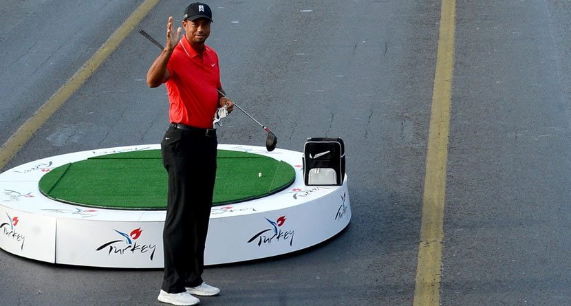 Tiger Woods Hits Golf Ball from Asia into Europe