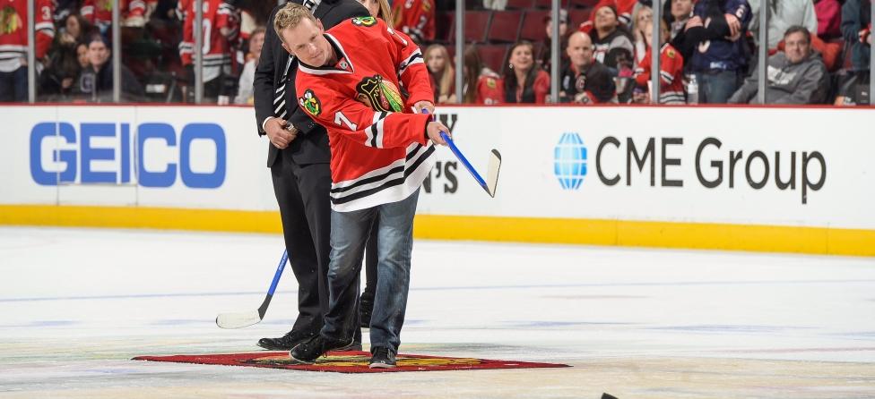 Luke Donald Takes Hockey Swings at Blackhawks' Game