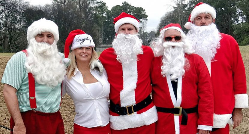 Santa Clauses Come To Town For Golf Tournament