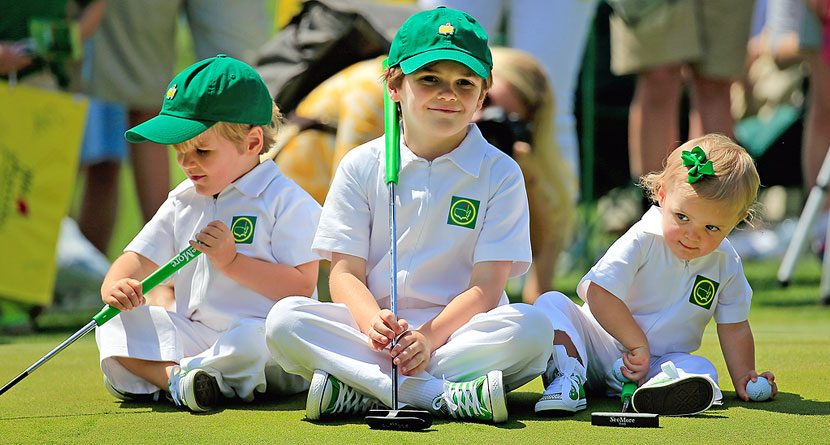 Wyatt, Will and Abby Johnson wait on a green during the 2014 Par 3 Contest prior to the start of the 2014 Masters Tournament at Augusta National Golf Club on April 9, 2014 in Augusta, Georgia. (Photo by Rob Carr/Getty Images)