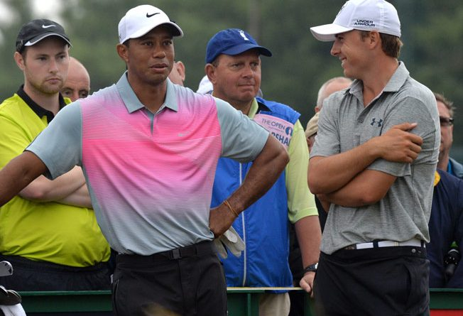 Tiger Woods and Jordan Spieth share a laugh during the 143rd Open Championship at Royal Liverpool Golf Course in Hoylake, north west England on July 19, 2014. (Photo by Paul Ellis/AFP/Getty Images)