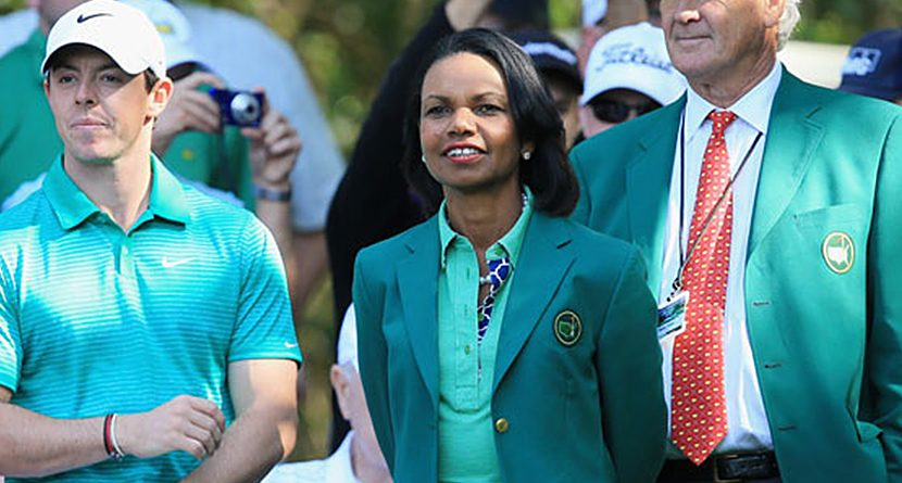 Rory McIlroy, Condoleezza Rice and Walter Driver watch the Par 3 contest prior to the Masters Tournament on April 9, 2014 in Augusta, Georgia. (Photo by David Cannon/Getty Images)
