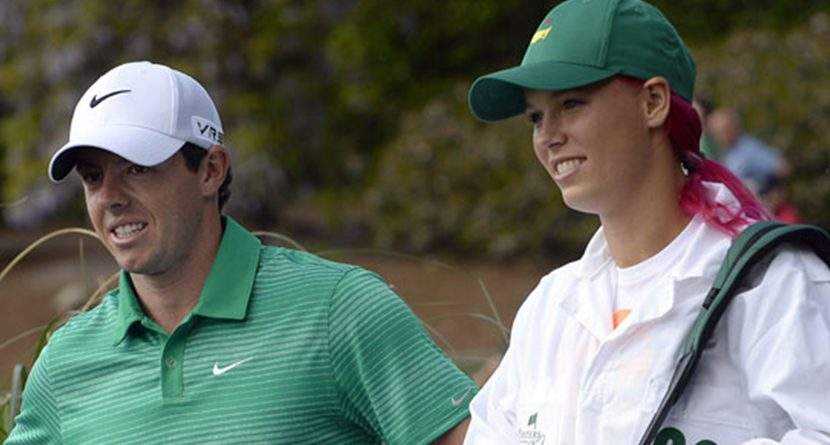 Rory McIlroy and Caroline Wozniacki wait during the Par 3 Contest prior the Masters Tournament on April 9, 2014 in Augusta, Georgia. (Photo by Timothy A. Clary/AFP/Getty Images)