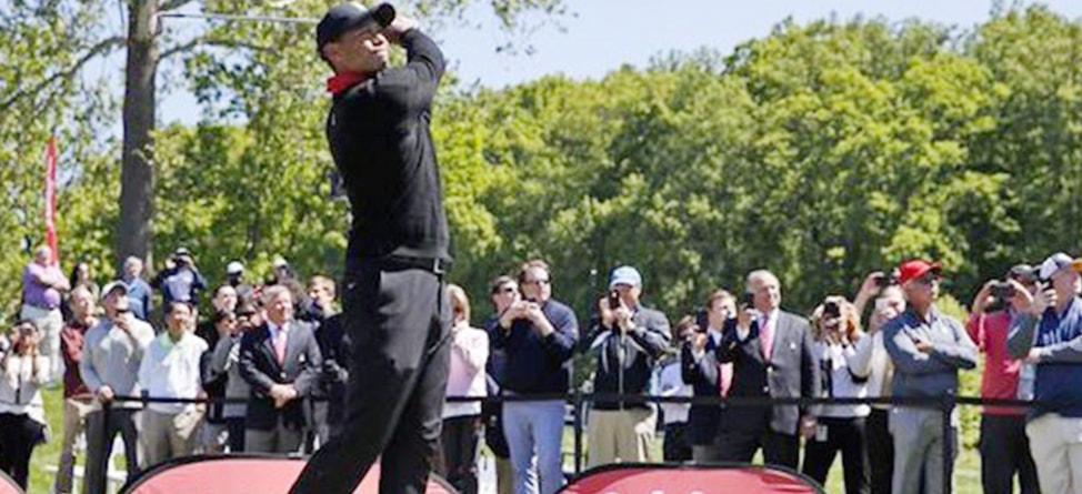 Tiger Rinses Three Balls At Quicken Loans Media Day