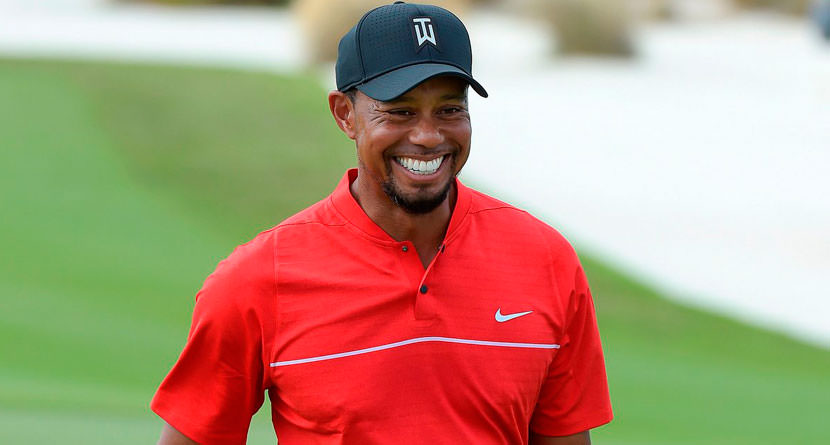 Tiger Woods Posts Driver Swing in Sunday Red