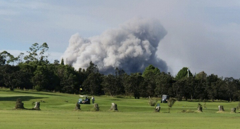 Golfers Play While Volcano Erupts In Background