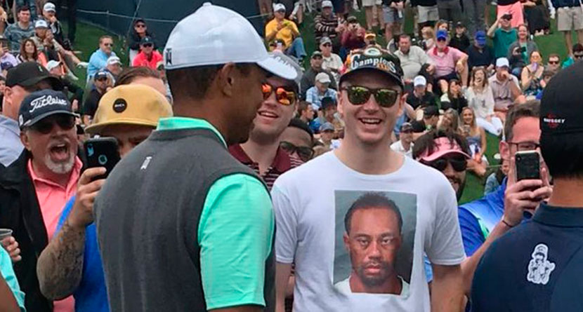 Tiger Stifles Laughter Seeing Fan's Shirt Of Mug Shot