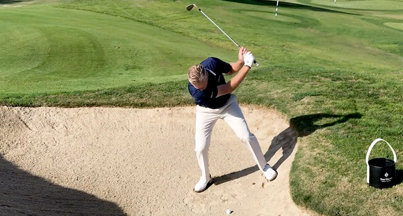 The Keys To Playing A Downhill Bunker Shot
